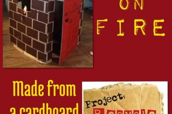 House on fire made from a cardboard box